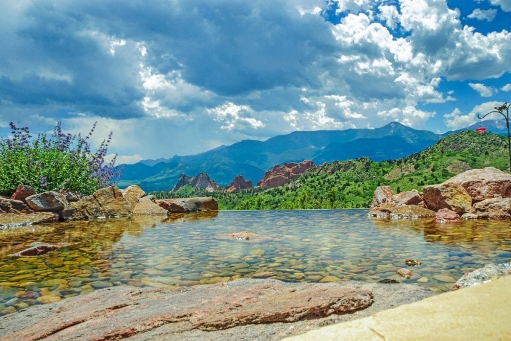 View of the beautiful Colorado Springs landscape from an infinity pondless water feature
