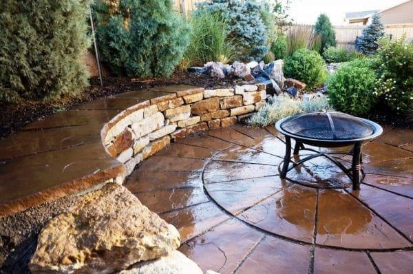 Patio and retaining wall for landscaping in small backyards