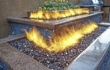 Outdoor Gas Fire Table In Colorado Springs Next To Grill