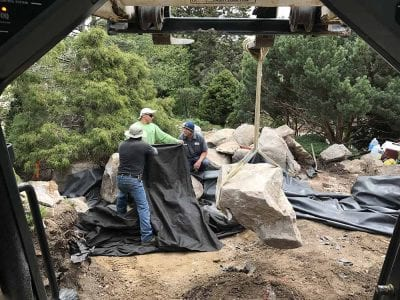 Setting A Boulder In A Pond - Colorado Springs