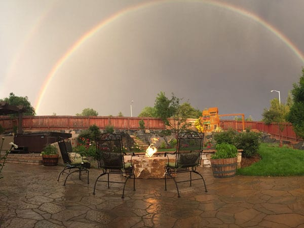 Double rainbow over a beautiful outdoor living space ideas