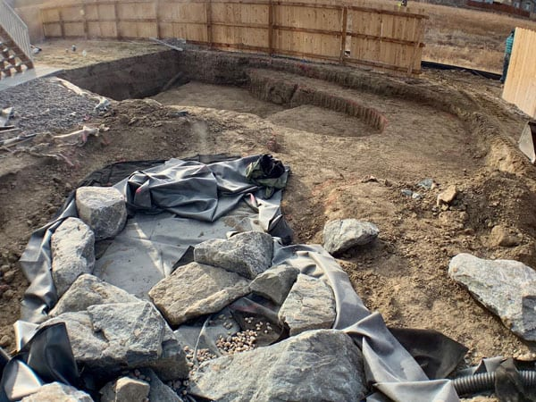 Adding liner and rocks to part of a water feature