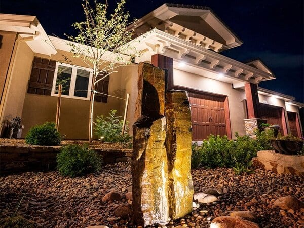 The best landscape lighting brands light up this fountain and outdoor area
