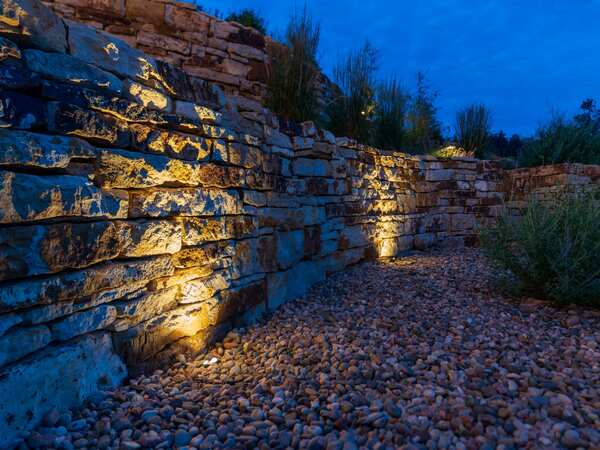 Uplights used on a retaining wall